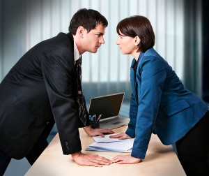 corporate blogging task stare off between executive man and woman